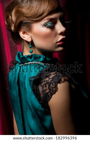 Portrait of a pretty retro girl in dark green wearing a cute hat  - stock photo