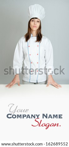 Portrait of a serious young female chef  - stock photo