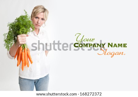 Portrait of a woman holding a bunch of carrots  - stock photo