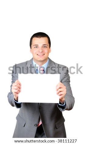 Portrait of a young man holding a blank banner isolated on white background