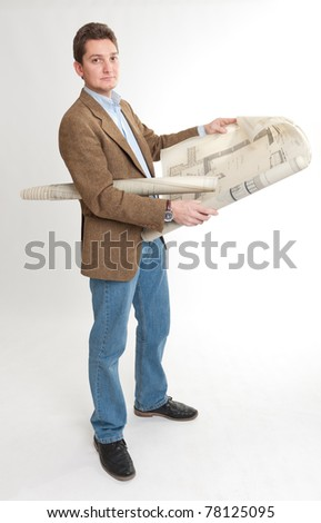 Portrait of a young man holding a roll of blueprints - stock photo