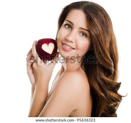 portrait of a young woman holding red apple with heart shape - stock photo