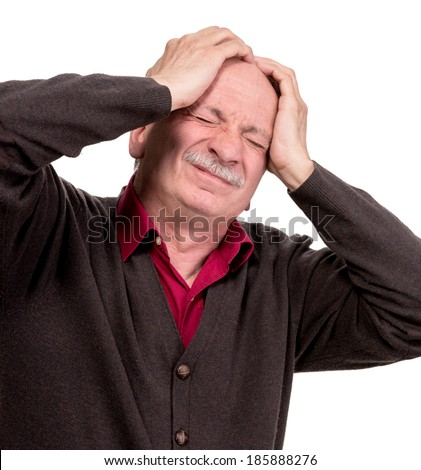 Portrait of an middle age man suffering from headache on a white background - stock photo