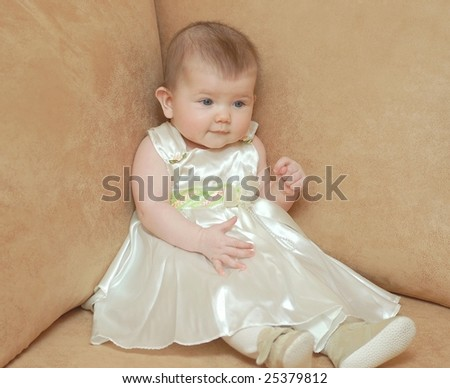 Portrait of baby girl in holidays clothes - stock photo