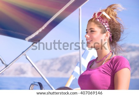 Portrait of beautiful woman driving a boat in bright sunny day, enjoying sea cruise on luxury sail boat, active lifestyle, summer vacation concept - stock photo