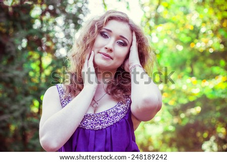portrait  of beautiful woman in nature - stock photo