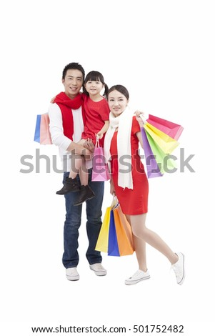 Portrait of daughter holding shopping bags,father carrying daughter in arms,mother holding shopping bags