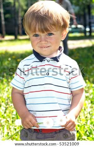 portrait of happy baby in park - stock photo