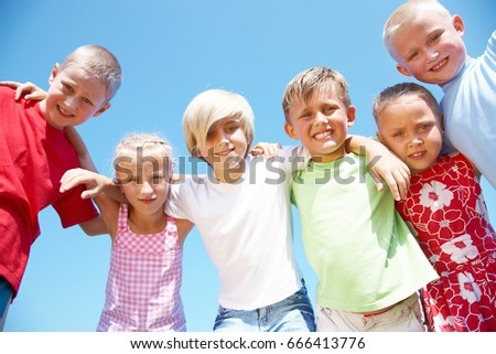 portrait of happy kids outdoor looking at camera in summertime