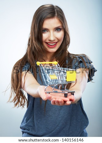 Portrait of happy smiling woman hold shopping cart. Female model isolated studio background. - stock photo