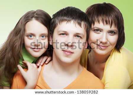 Portrait of joyful family laughing and looking at camera on white background - stock photo