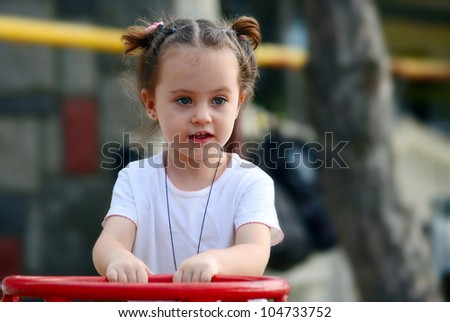portrait of little beautiful girl outdoor