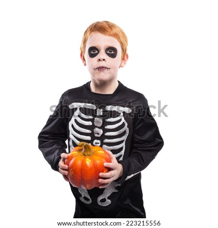 (  Portrait of little red haired boy wearing halloween skeleton costume and holding pumpkin. Studio portrait isolated over white background - stock photo