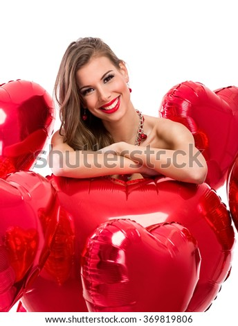 Portrait of smiling woman with Valentine's heart - stock photo
