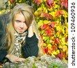 Portrait of the beautiful girl in autumnal  season - stock photo
