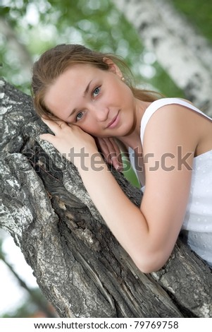 Portrait of the girl in a birchwood.