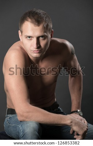 Portrait of the man on a black background - stock photo