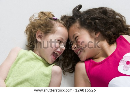 Portrait of two girls laughing - stock photo
