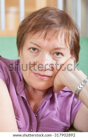 Portrait of  woman at  age of sadness about something - stock photo