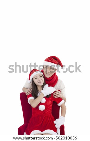 Portrait of young couple wearing Santa hats,smiling