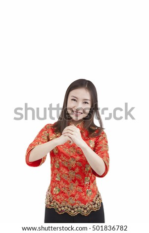 Portrait of young woman in Tang suit paying New Year call