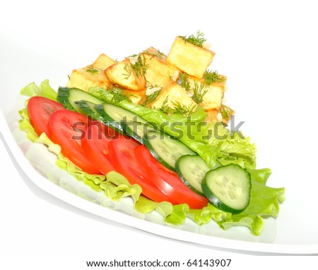 Potato country style with dill and garlic, fresh vegetables on white background