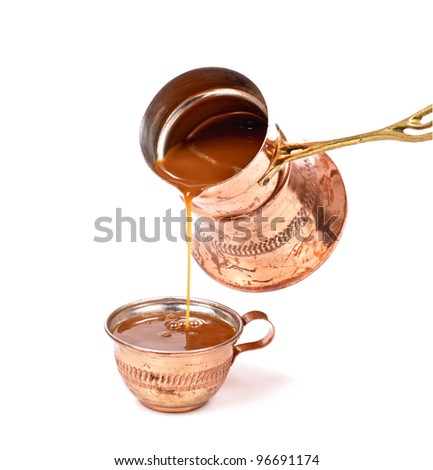 pouring coffee on a cup,copper cups - stock photo