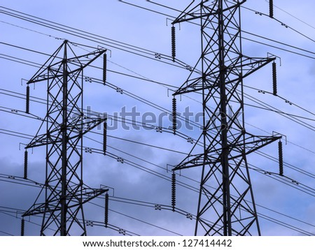 Power lines backed by a stormy sky. - stock photo