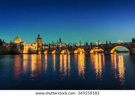 Prague ,view of the Lesser Bridge Tower of Charles Bridge (Karluv Most) at dusk, Czech Republic.  - stock photo