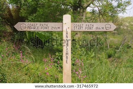 """Prawle Point, Start Point, Lannacombe"" Signpost on the South West Coastal Path on the South Coast  in Devon England, UK - stock photo"