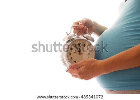 Pregnant woman with clock on a white background