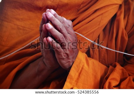press the hands and  holy thread abstract for worship in buddhism religion