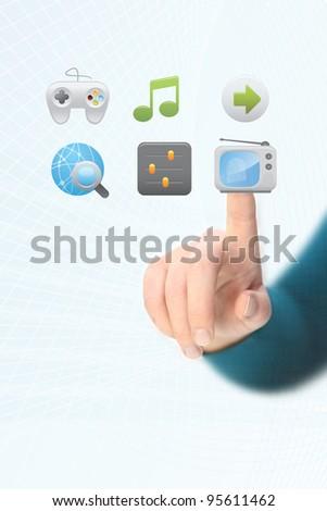pressing a TV button - stock photo