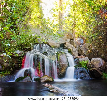 pretty waterfalls (slow shutterspeed for cascading water softening)  - stock photo