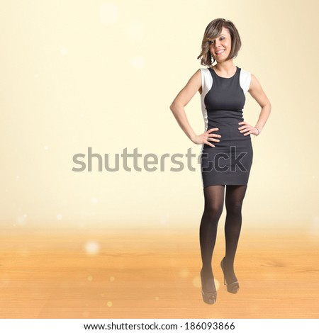 Pretty woman over ocher background