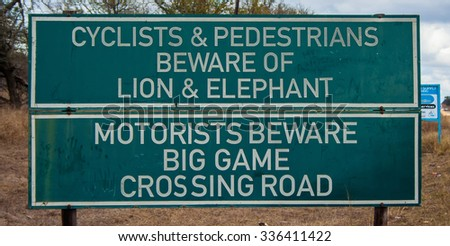 Preview Stock Photo: A road sign warning pedestrians and cyclists to beware of lions and elephants on a road in Swaziland, Africa. - stock photo
