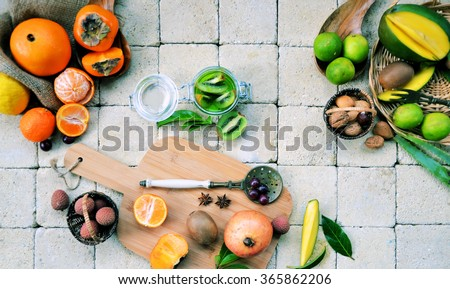 process of preparing a smoothie with tropical fruits, cooking concept ,organic food - stock photo