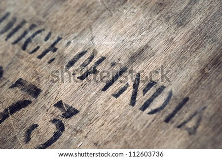 """Produce of India"" printed on very old dirty wooden box - stock photo"