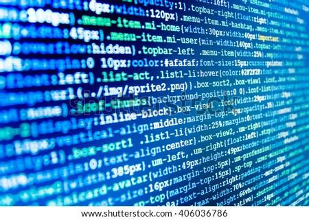 Programming code.  Programming code abstract screen of software developer. Programmer workplace. Website development. Technology background. Website programming code. Blue color background. - stock photo