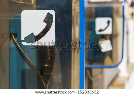 Public phone on the street. - stock photo
