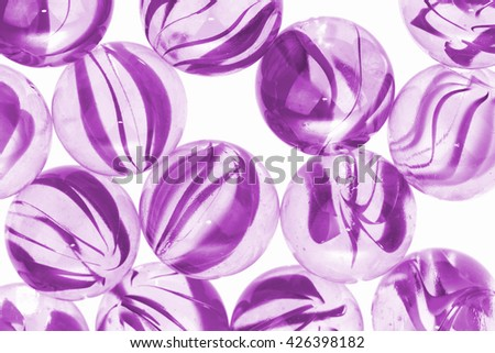 Purple glass marbles on white background. Macro image - stock photo