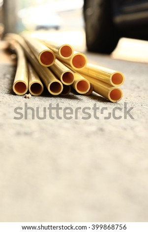 PVC pipes for electric conduit (yellow) and water  - stock photo