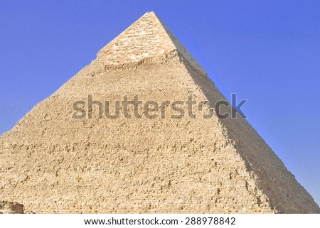 Pyramid of Cheops in Cairo, Egypt, against the blue sky on a sunny day - stock photo