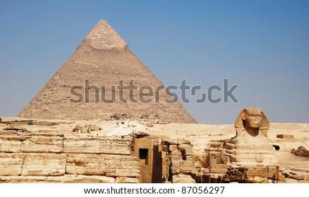 pyramid of giza and sphinx - stock photo