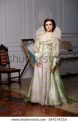 queen in royal dress  - stock photo