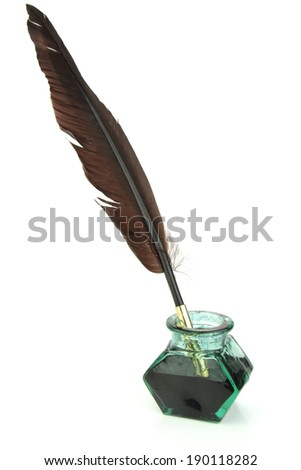 Quill pen in glass ink bottle - stock photo