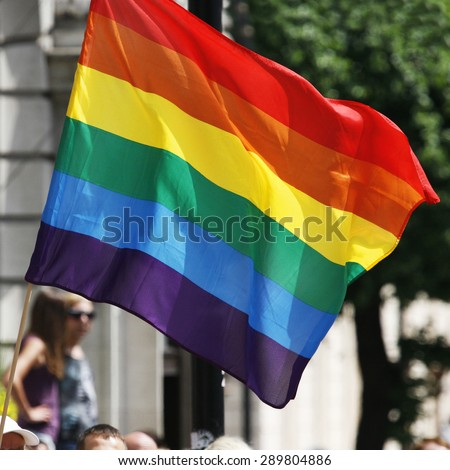 Rainbow flag waiving in London's Gay Pride - stock photo