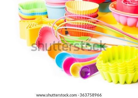 Rainbow silicone confectionery utensils - stock photo