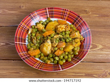 ��rakos  - greek cuisine.green peas with tomato sauce and potatoes. - stock photo