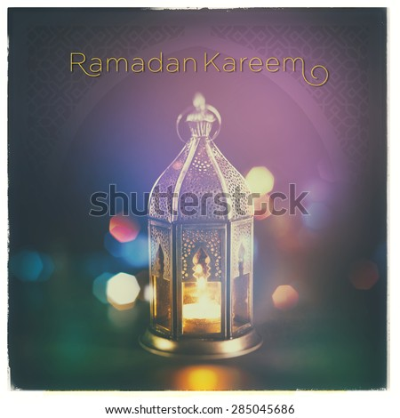 'Ramadan Kareem'. A beautiful greeting card with english headline over islamic lamp background. - stock photo